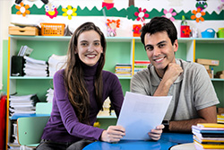 Educational Advocacy image of a young women and young man sitting at a table in a classroom setting