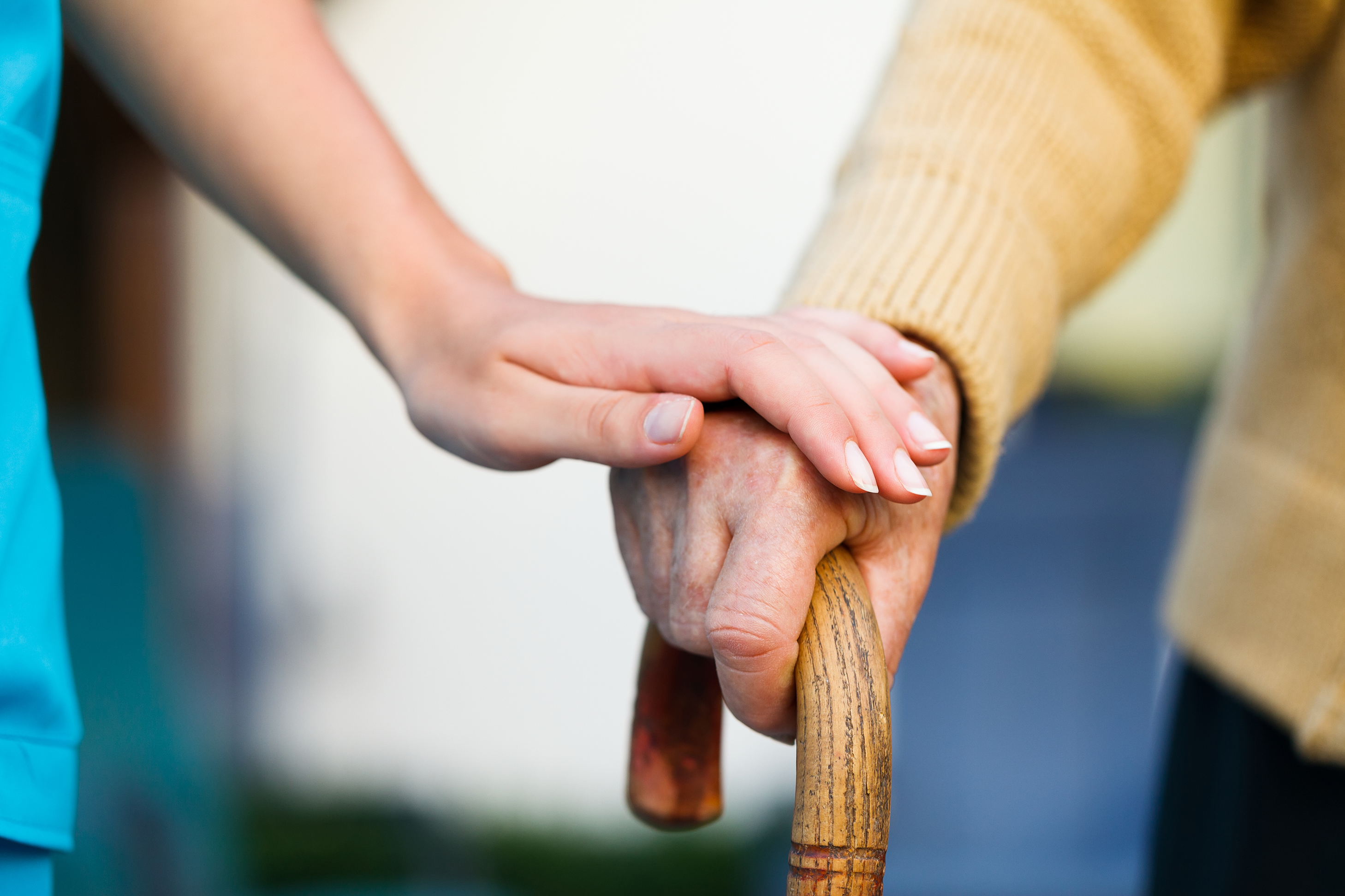 Picture of Supportive Caregiver Hands & Elderly Hands on Cane